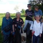Five people taking part in a litter pick
