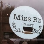 A window signing reading 'Miss B's Pantry'