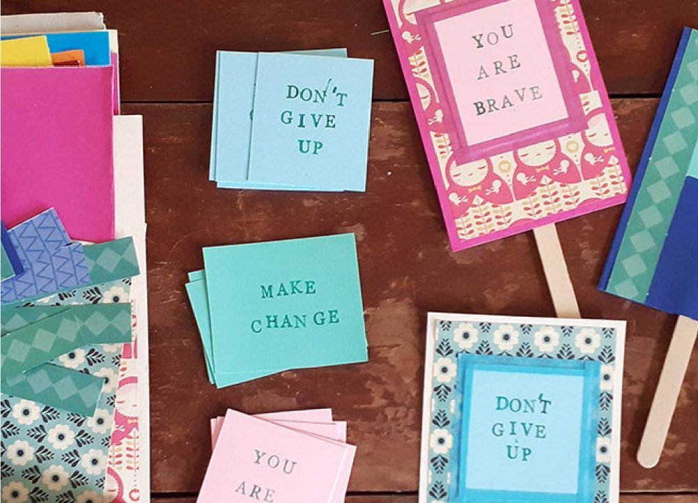 Colourful homemade mini cardboard placards reading 'You are brave' and 'Don't Give Up'