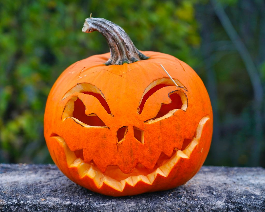 A pumpkin carved with a toothy face